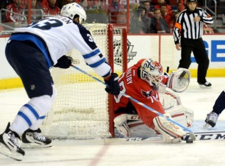 Braden Holtby had saves as the Capitals defeated the Jets 4-2. photo by the canadian Press