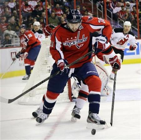 Troy Brouwer moves the puck. Brouwer has 3 goals in his last 2 games. The Capitals defeated the Devils 3-0. photo by the Canadian Press