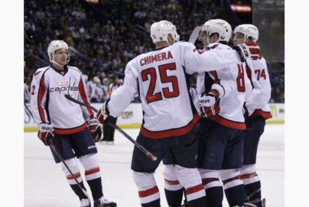 Alex Ovechkin is congratulated by his teammates after scoring his 50th goal of the season. The Capitals defeated the St. Louis Blues 4-1. photo by Tom Gannam