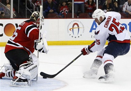 Corey Schneider denies Jason Chimera's shot. The Devils defeated the Capitals 2-1. photo by